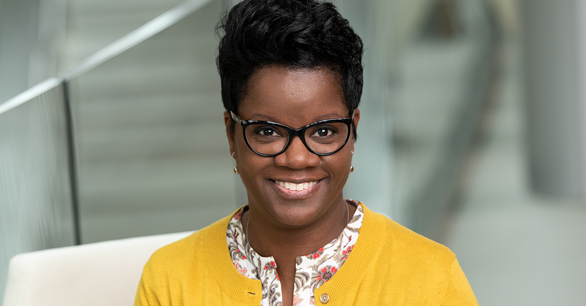 Capital One Tech associate in yellow talks about the Julie Elberfeld Fusion Award and the impacts Capital One's group Blacks in Tech are having in their communities