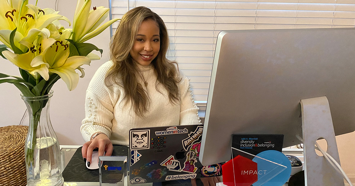 Capital One Tech associate, Niaya, who was recognized as the 2020 Julie A. Elberfeld Tech Diversity, Inclusion and Belonging Impact Award winner, sits at her work from home office