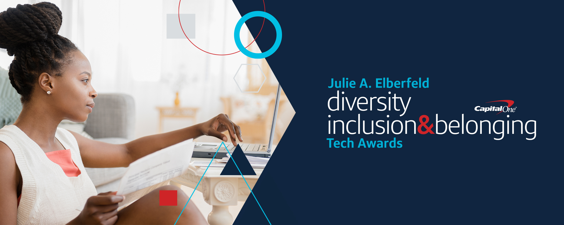 Woman sits at laptop and talks about the Julie A. Elberfeld Tech Diversity and Inclusion awards at Capital One