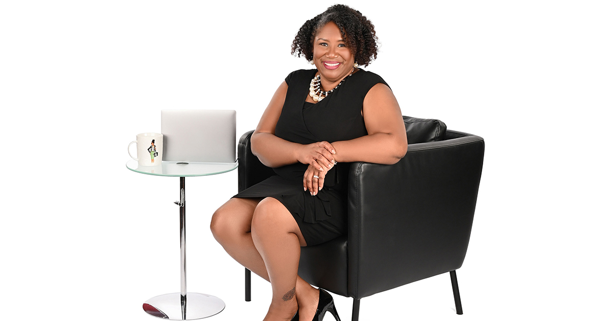Dr. Jennifer J. Bryant, Director of Associate Experience for the Cyber Team at Capital One who won the Julie A. Elberfeld Tech Diversity, Inclusion and Belonging Awards Trailblazer Award, sits in a white room.