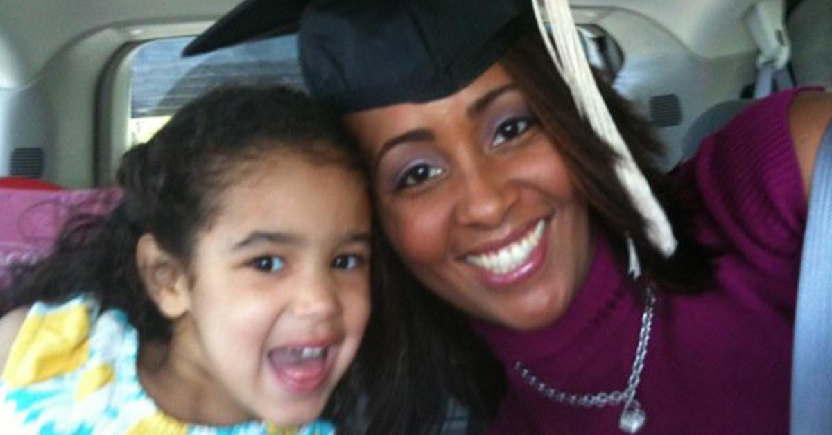 Capital One associate Judith wearing her graduation cap with her daughter
