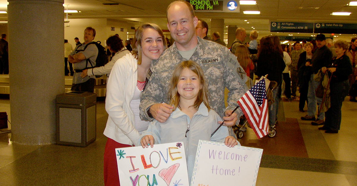 Chris, a Tech leader at Capital One, is welcomed home by his family in the airport in his digis after a long Afghanistani deployment