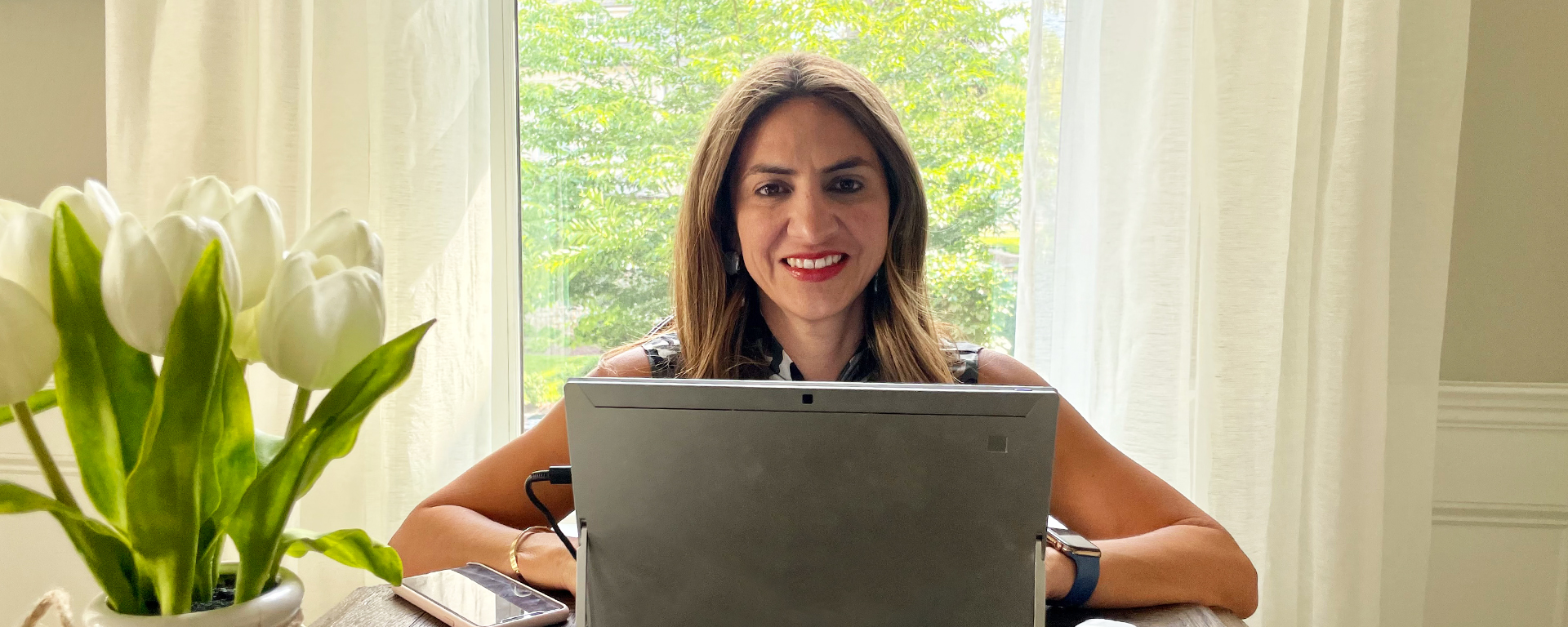 Cinthia Lopez, Capital One VP of Students and Grads Recruiting and Programs, sits at her desk behind her laptop and talks about the lessons she's learned in leadership