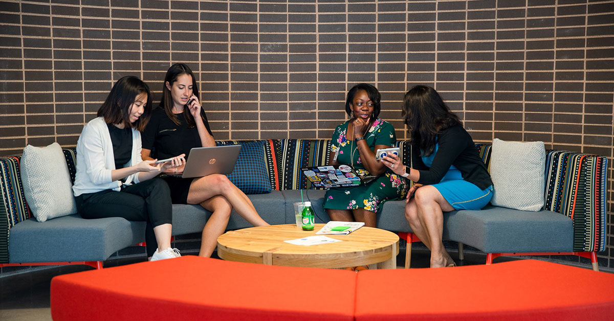 women discussing personal brand