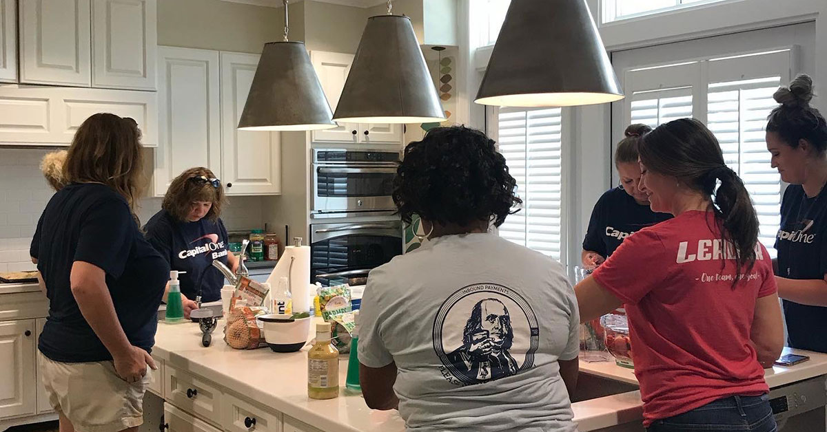 Capital One Inbound Payments process team volunteer event at cleaning and cooking for house guests staying at house guests staying at Evelyn D. Reinhart Guest House