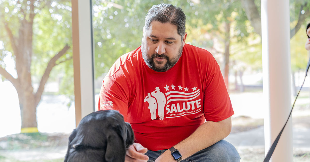 Capital One partnering with Patriot PAWS, a non-profit organization, to raise a service dog in training in the office setting
