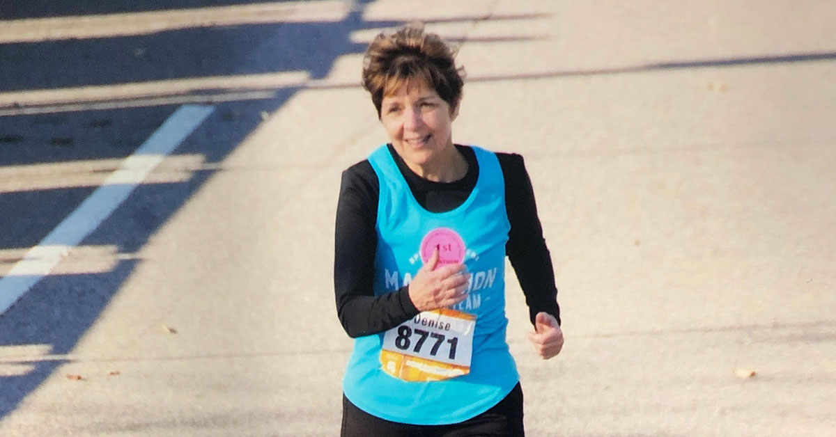 denise running a marathon at the finish line