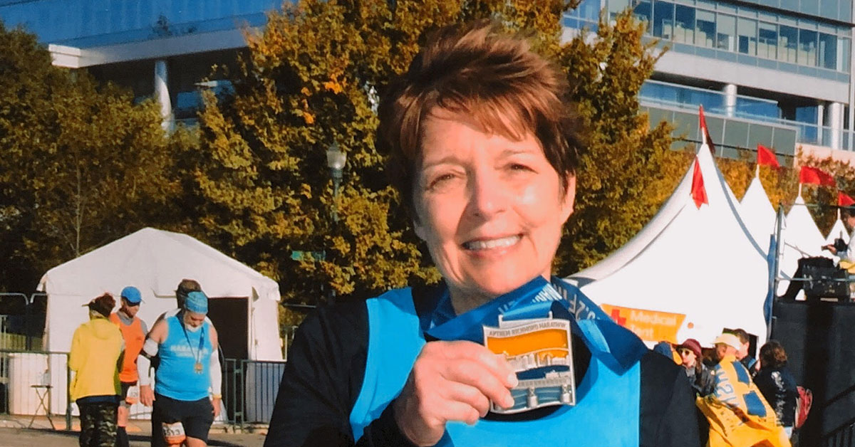 denise showing her medal after the race