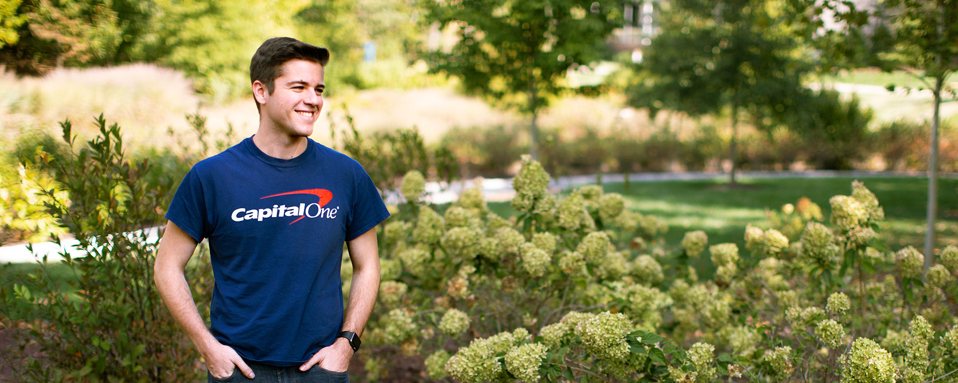 tech recruiter standing outside in capital one shirt