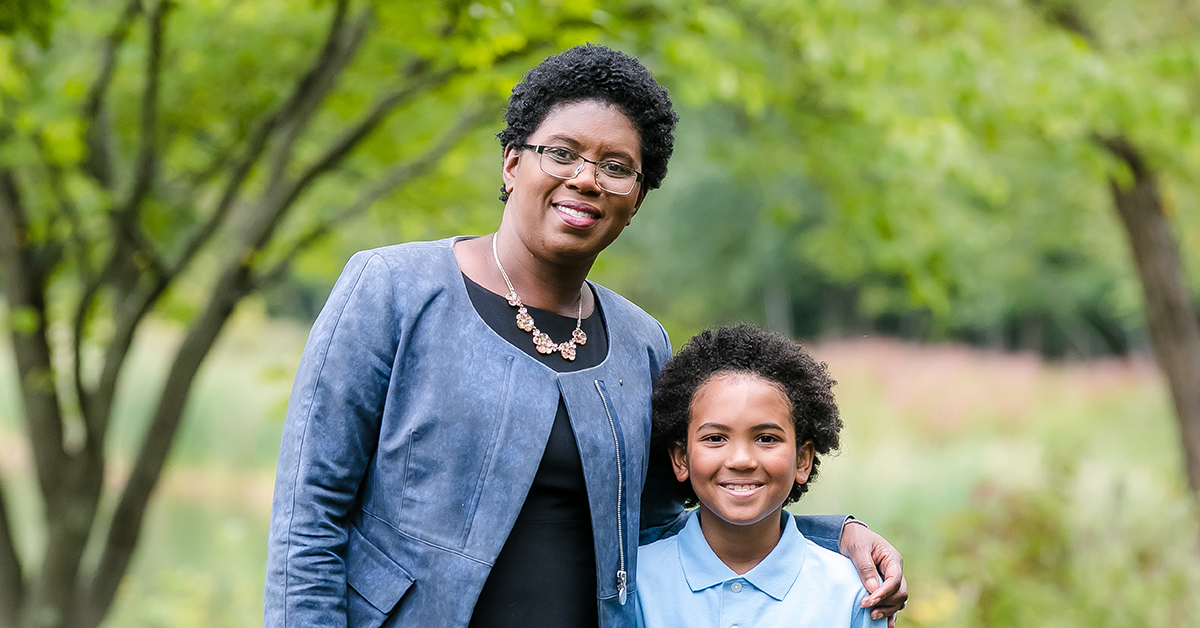 Capital One HR Tech leader Maureen Jules-Perez stands outside with her son and shares her thoughts on Diversity