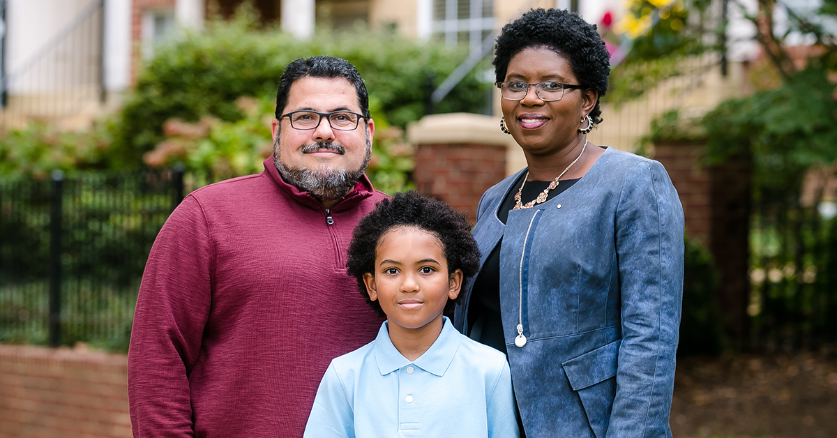 Capital One HR Tech leader Maureen Jules-Perez stands outside with her family and shares her thoughts on Diversity