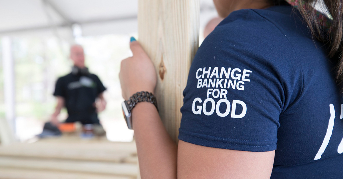 Capital One associate volunteering and wearing a Change Banking for Good shirt