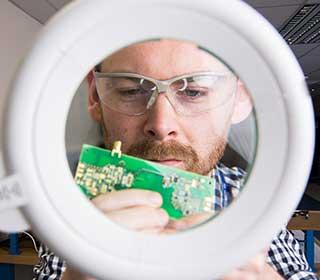 Researcher inspecting a microchip