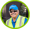 Smiling man in safety vest and hat