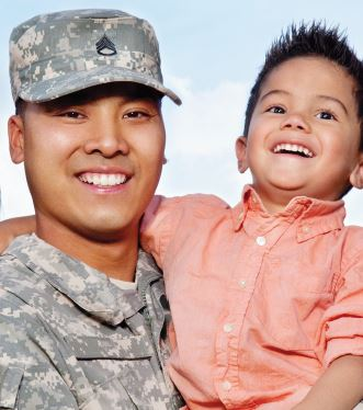 military father and son smiling