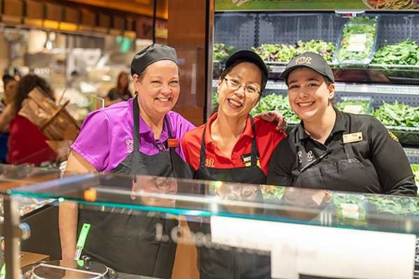 team members smiling at you