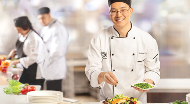 Chef serving a large plate of food at an in-store restaurant