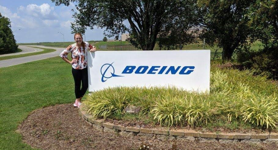 Abbey Carlson standing in front of Boeing signage.