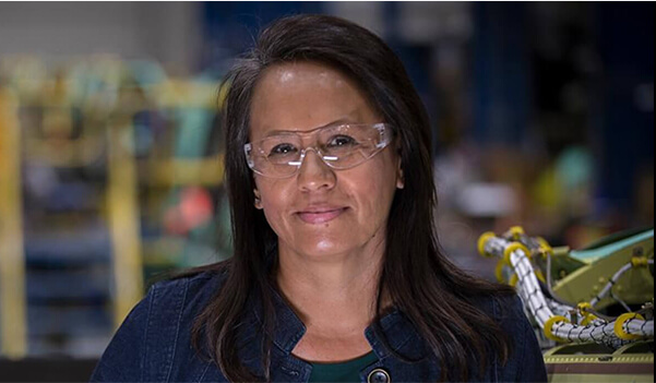 Lady smiling and wearing safety glasses