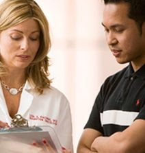 Boston Medical Center doctor discusses chart with patient