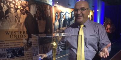 man standing behind display case