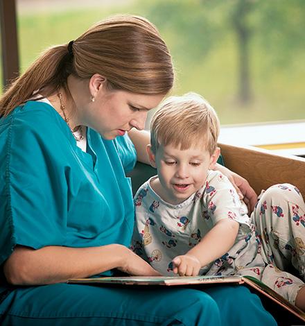 nurse reading with child