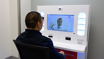 Man in front of a video conference machine