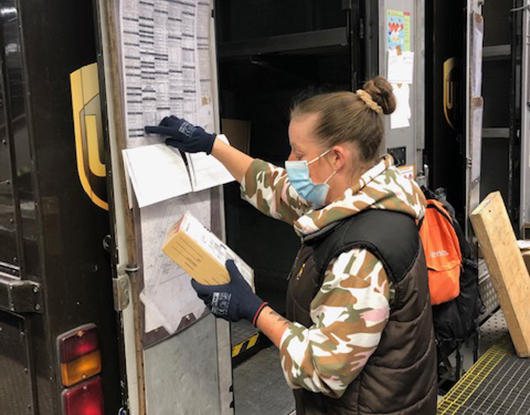 Nadine - Wearing mask and checking a chart