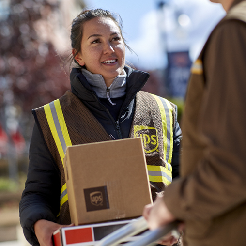 Employees delivering packages and woman employee is smiling