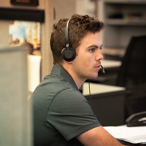 Employee with a telephone headset on.