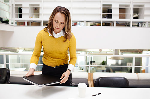 Picture of a woman sitting down at a meeting room table