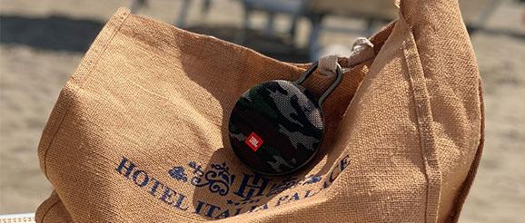 jbl portable speaker hanging on the handbag