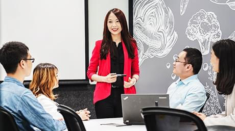 woman presenting to a group of coworkers