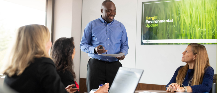 Man giving presentation to group of employees