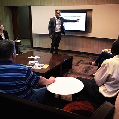 Employee presentation to a group.
