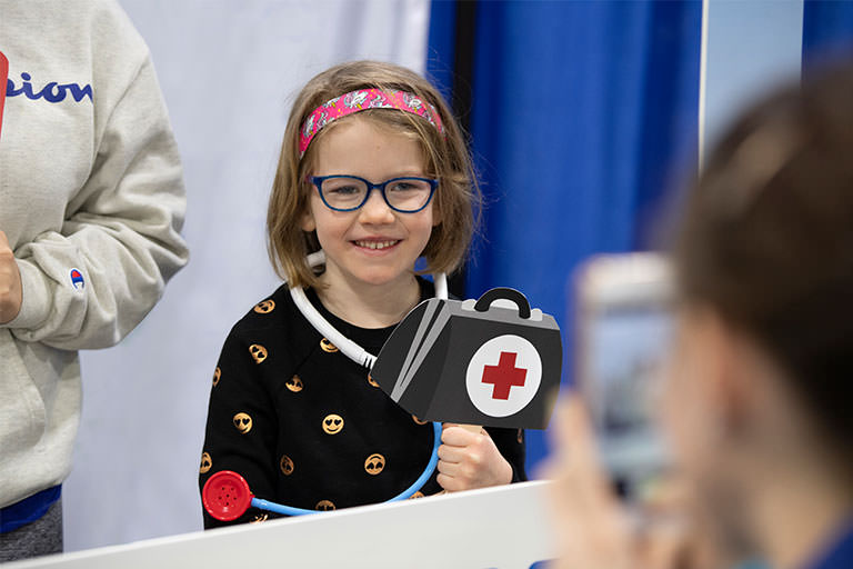 Young Girl Holding Medkit