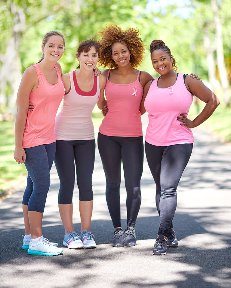 Four women wearing clothes for running