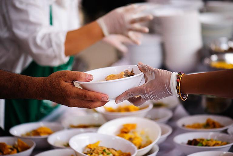 Handing food to someone