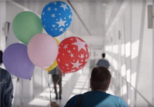 Nursing walking with balloons
