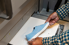 man working on a shoe