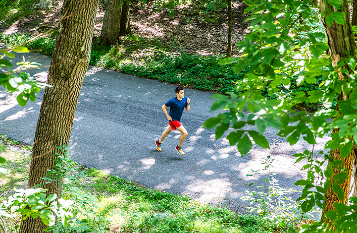 Christian running on the road