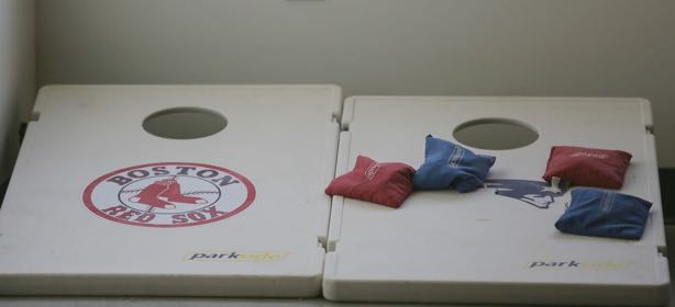 Boston Red Sox and New England Patriots logos on a bean bag toss game.