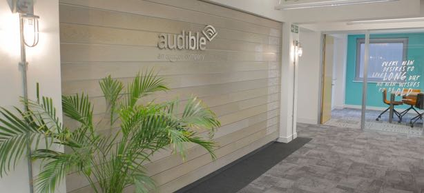Office interior entrance with Audible logo on the wall.