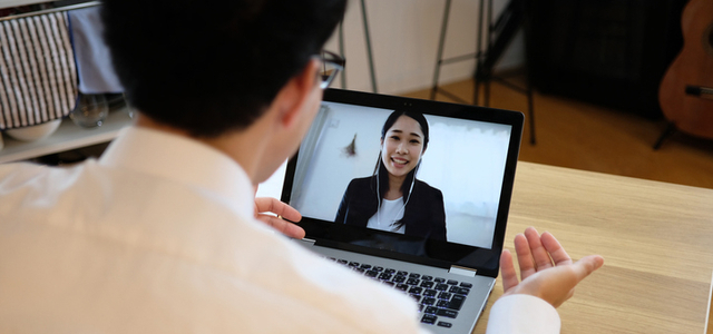 Man having video call on laptop with woman