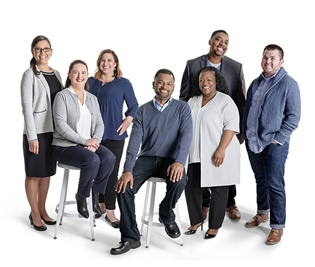 Diverse mix of Tax & Bookkeeping Experts smiling in a group setting