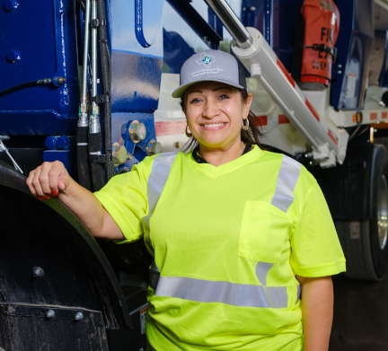 Woman standing in front of Waste Connections truck