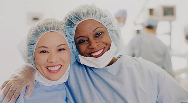 Two female OR Doctors, smiling