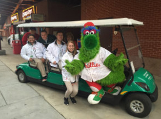 Philly colleagues jump at the chance to combine baseball fun with customer engagement.