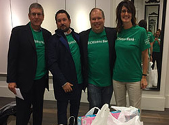 Executive Leadership Group (ELG) joining forces to shop for local families in need.