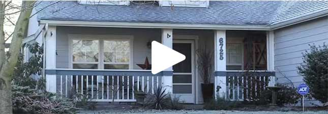 A still from a video showing the front porch of a house